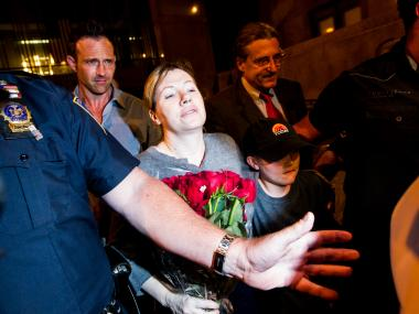Anna Gristina leaves Manhattan Criminal Court on June 26, 2012, with her husband and son.
