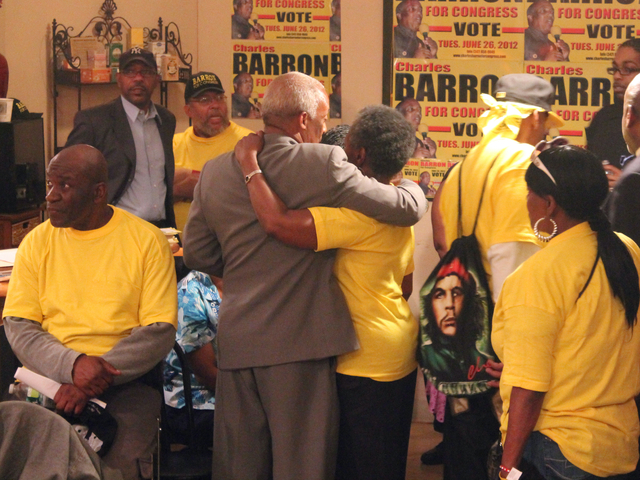 Charles Barron stands with volunteers before he makes a speech to his supporters.