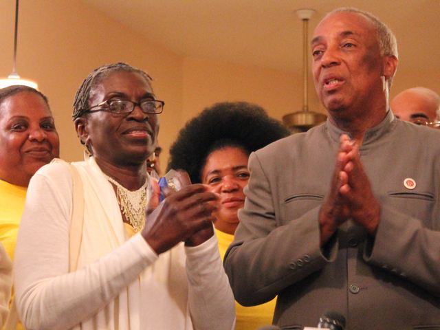 Charles Barron makes a speech to his supporters standing next to his wife.