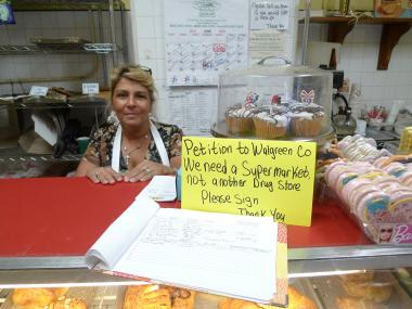 Marie Sirota, owner of Regina Bakery on Prospect Avenue and Prospect Park West, collected signatures from locals who don't want Walgreens to replace Key Food.