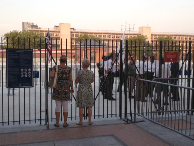 Security workers gathered around the McCarren Pool.