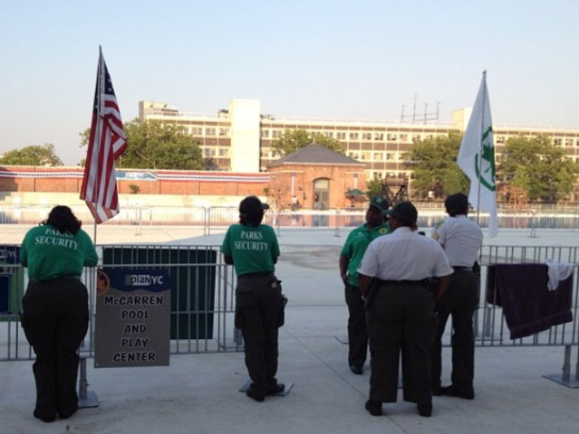 Workers from the Parks Department shut down the McCarren Pool after a brawl June 29, 2012.