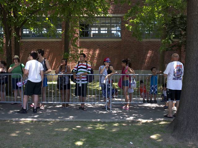 Crowds waited to get in to the newly opened McCarren Park Pool on Saturday, June 30, 2012.