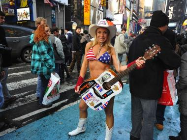The Naked Cowgirl gives a performance in Times Square.