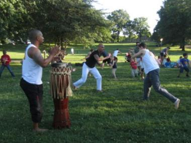 Capoeira combines martial arts with fitness and dance. Free family capoeira, sponsored by Bread & Yoga, in Inwood Hill Park, Wednesday, June 27, 2012.
