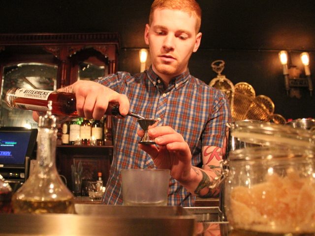 Colin DeCarutel, at Gin Palace, builds a gin and tonic the old fashion way. The bar also serves gin and tonics on tap.