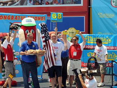 Joey Chestnut, after downing 68 hot dogs to take the crown for the sixth time in a row at the Nathan's Famous Fourth of July International Hot Dog Eating Contest on Coney Island Wednesday, July 4, 2012.