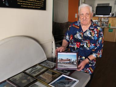 Frank Carrado preparing his photo exhibit at the New York Irish Center