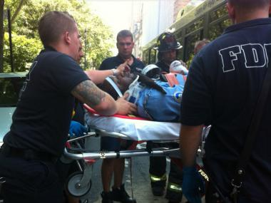 The driver of the M10 bus was removed on a stretcher after the bus was hit by an SUV on Central Park West July 6, 2012.