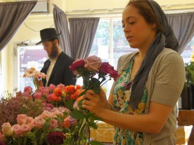 Mookie Cohen, 21, makes a flower arrangement at Mimulo flower shop in Crown Heights. The five-year-old store's edgy bouquets have become de rigueur among the neighborhood's young Hasidic couples.