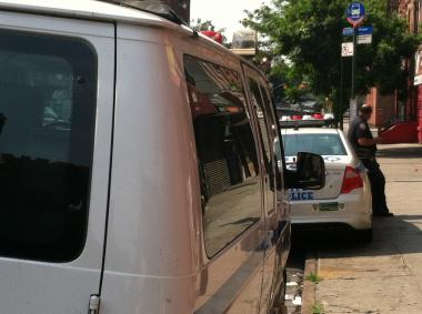 Police van outside the home of a woman suspected in killing her son in an apparent murder-suicide on July 6, 2012.