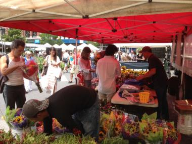 Shoppers survive the heat in the Union Square Farmers' Market on July 7, 2012.
