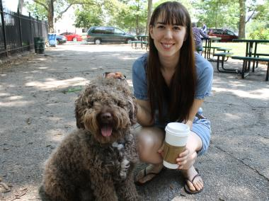 Kika Espejo and her dog Moses stayed in the shade of McCarren Park to hide from the heat. Espejo said she is about to cut Moses' hair and make the fur into a pillow.