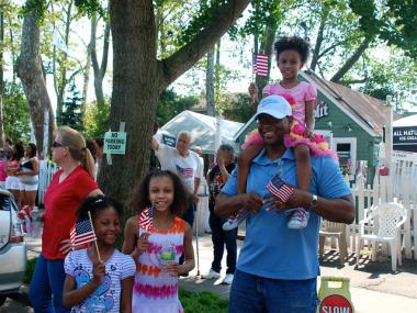 Families watch the  Memorial Day parade on City Island on May 28, 2012.