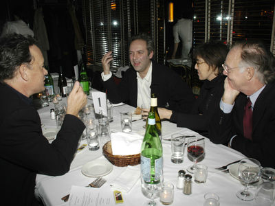 Ephron, middle, with husband Nicholas Pileggi (r), Tom Hanks (l), and Sam Mendes.