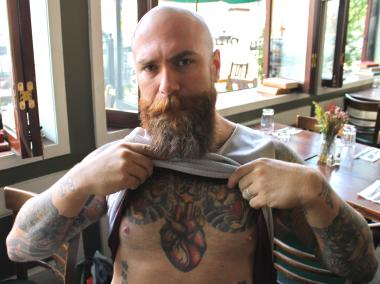 Bravo Roughan, a bouncer at the bar Union Pool, said his heart tattoo is the most meaningful for him.