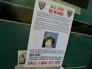 A police poster outside the building at the Pelham Parkway Houses where Evelyn Shapiro was beaten to death on June 16, 2012. That development and one other in The Bronx are set to get new security cameras and equipment.