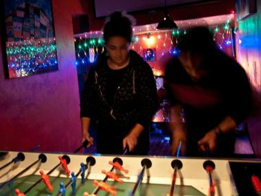 Patrons play foosball at Bar 718 on Brooklyn's Fifth Avenue in Sunset Park.