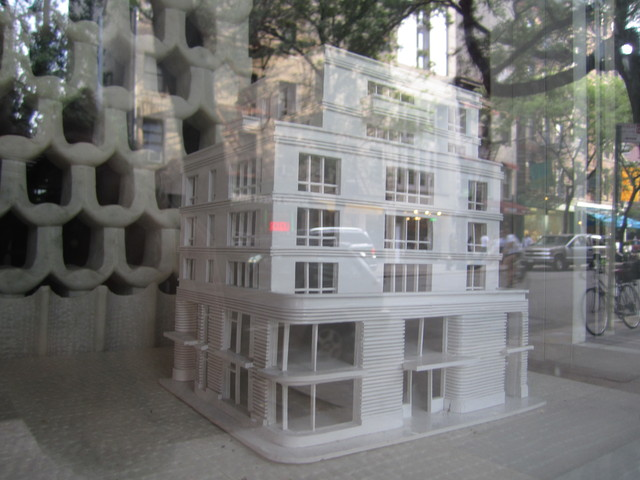 A model of the seven-story mixed-use development planned for 182 Spring St. is on display on the block.
