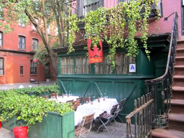 The Waverly Inn was open for business, complete with its beloved mural of famous Village residents, July 10, 2012.