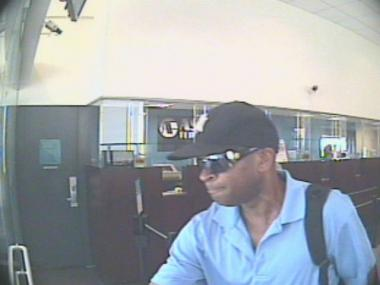 Cops say this man held up an Astoria Federal Savings Bank at gunpoint.