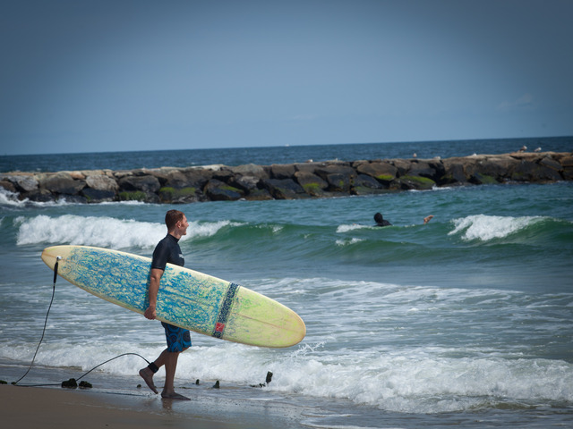 Surfing at Rockaway Beach.