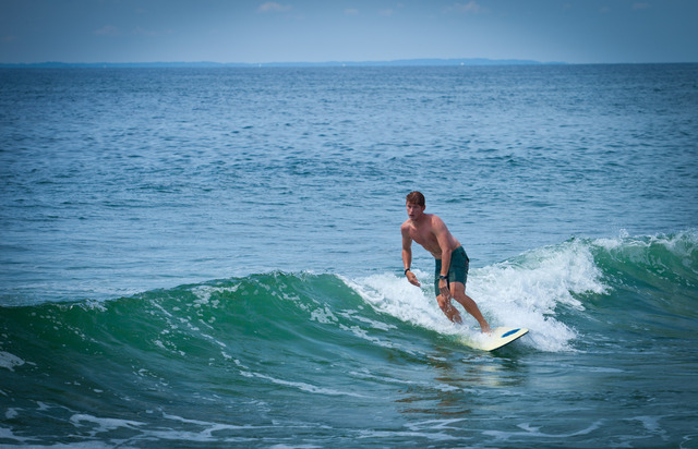 A surfer from California at Rockaway Beach on July 11.