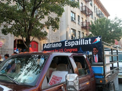 Espaillat's campaign poster-covered truck still reads