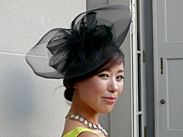 the very social and stylish accessory designer Tana Chung in a sheer and divine fascinator