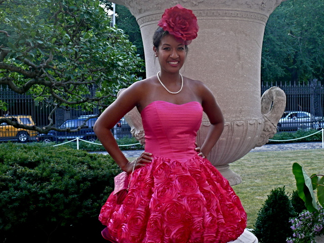 Festive, dramatic vivid fuchsia, rose patterned puff dress on Frick member Allison M. Ecung