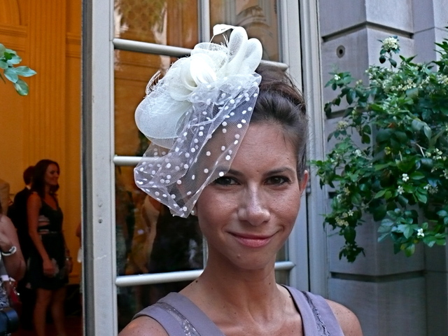 A wonderfully asymmetric white fascinator with dotted net on Kelly M. Maslick