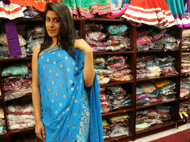 Mariam Shabbir, 19, shows-off a printed blue chiffon sari.