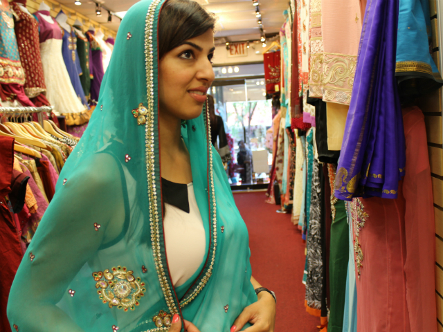 A sea green colored sari is soothing and pretty.