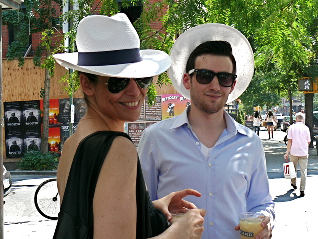 Very stylishly  incognito in jaunty white straw hats from Pernod Ricard.