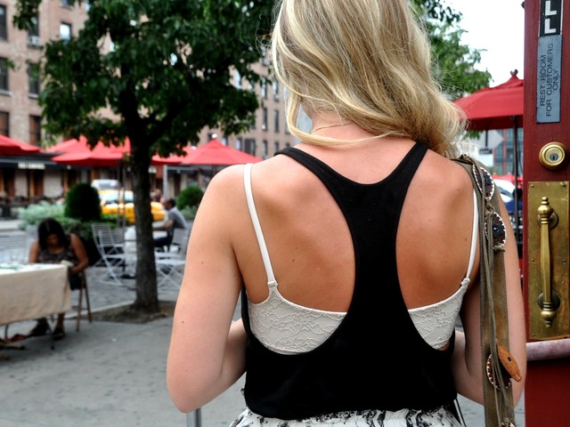 Annie Gauntlett, 25, shows off her bra in the Meatpacking District.