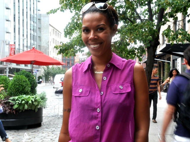 Candice Tasker, who lives in Brooklyn, wearing a sheer purple blouse. Her black lace tube top is visible through the shirt, a style that many women have started wearing.