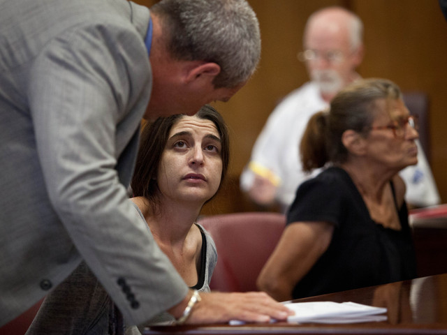 <p>Jennifer Sultan, 38,talks to her lawyer at the court on July 13, 2012.</p>