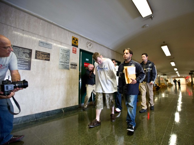 <p>Nicholas Mina (first in line) was taken to court on July 13.</p>