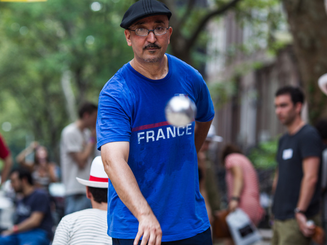 Kamel Gaiu, 51, from Marseille in France plays his favorite sport of petanque at Bastille Day in Brooklyn on July 15th, 2012.