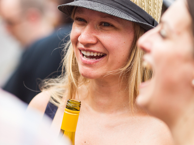 A young woman enjoys some French white wine at this Bastille Day celebration in Brooklyn on July 15th, 2012.