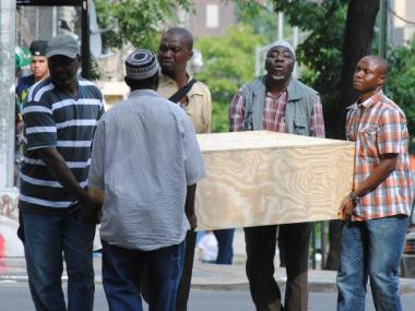 Five men carry a casket holding Ebrima Wally, 10, who died Saturday, July 14, after falling from a fence along the Harlem River.