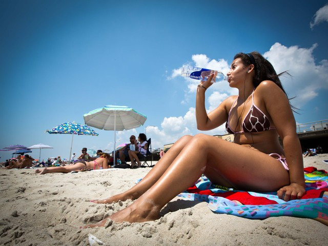 Neyla Sassi, 20, from Woodside, Queens, soaks up the rays on Rockaway Beach on Monday, July 16, 2012.