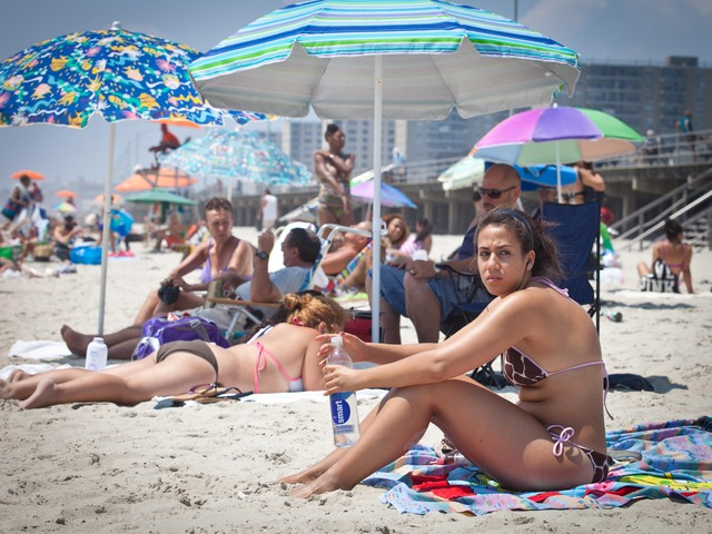 Neyla Sassi, 20, from Woodside, Queens, stayed in the water as a way to cool off the heat. She said she come to the beach three times a week.