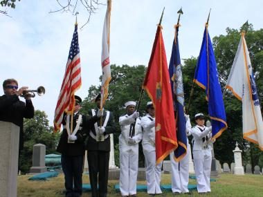 A trumpeter played 'The Star-Spangled Banner' to open the small ceremony at Greenwood Cemetery to honor the ten fallen New Yorkers, who died 164 years ago.