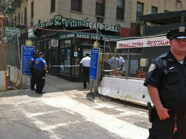 A police officer stands guard at East 86th Street and Second Avenue on July 17, 2012.