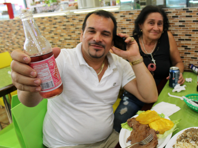 A family enjoys Postobón soda with their lunch.