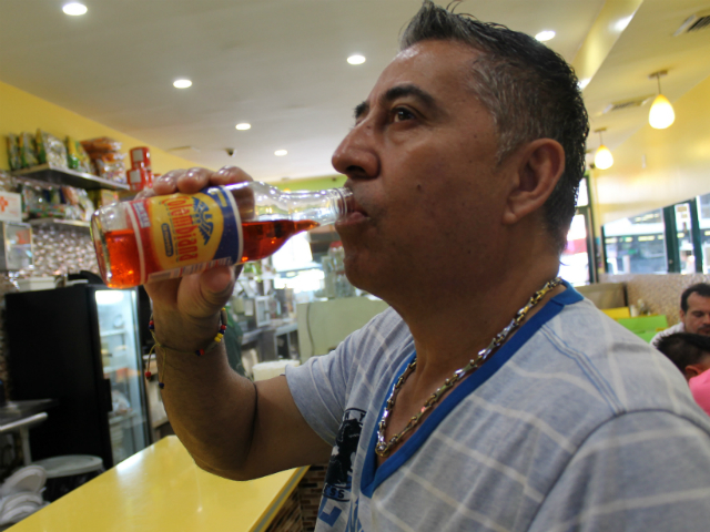 Jackson Heights resident Mario Campo, 42, enjoys a Postobón soda with his lunch.