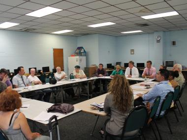 A meeting about a BID at St. Sebastian's Parish Center in Woodside.