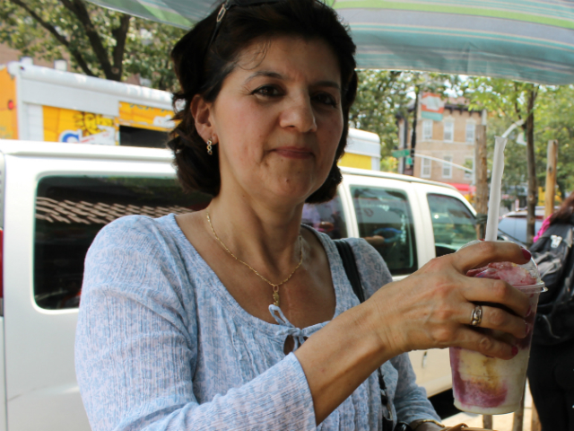 Rego Park resident Lillian Serna enjoys a cool Raspado at Los Americas Bakery on 82nd Street and Roosevelt Avenue.