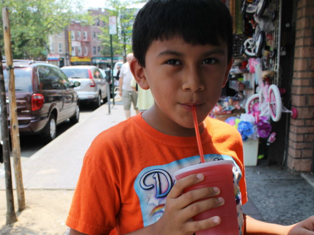 Jonathan Quezada, 10, of East Elmhurst enjoys a strawberry slushy